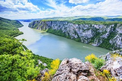 Panoramic view of amazing gorge on the Danube river , seen from the viewpoint at Serbian side, Serbia and Romania border. Spring nature landscape.