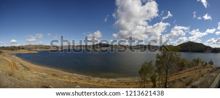 panoramic view of an almost full water resevoir/dam in Rural New South Wales during a drought, very dry season, local water supply used in farming, Australia
