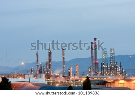 Panoramic view of an oil refinery at night