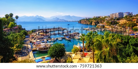 Panoramic view of Antalya Old Town port, Taurus mountains and Mediterrranean Sea, Turkey