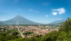 Panoramic view of Antigua Guatemala with the three volcanoes in the background