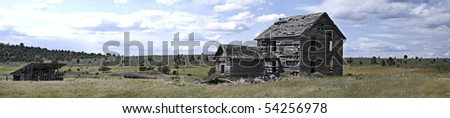 Panoramic view of back of 19th century homestead house with horse barn and windmill.  Measures 55.296\