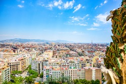 Panoramic view of Barcelona cityscape full of buildings  and the sculpture the  white dove of freedom of Sagrada Familia, Barcelona, Spain