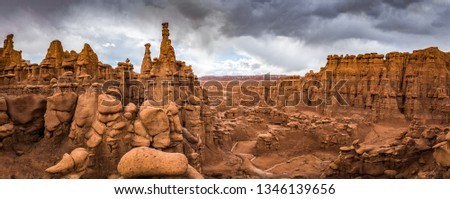Panoramic view of beautiful hoodoos sandstone formations in Goblin Valley State Park during a summer thunder, Utah, USA