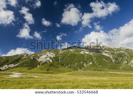 Shutterstock Panoramic view of beautiful landscape with Gran Sasso d'Italia peak at Campo Imperatore plateau in the Apennine Mountains, Abruzzo, Italy