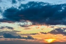 Panoramic view of beautiful sky during sunset over tropical island. Colorful sky with overcast cloud and glowing sunset in evening. Cloudy sky. Cloudscape and skyscape at Lipa Noi beach, Samui island.