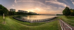 Panoramic view of Bedok Reservoir, Singapore during sunset hours. Photographed as composite images to form HDR Panorama in final image.
