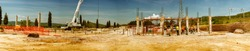 Panoramic view of building construction site.