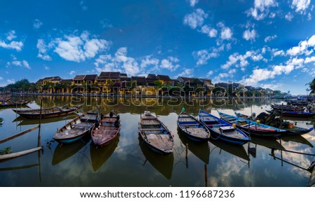 Panoramic view of busy river in Hoi An, Vietnam. Hoi An is the World's Cultural heritage site, famous for mixed cultures and architecture.         #1196687236