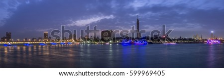 Panoramic view of Cairo city center at twilight, the Kasr El Nile Bridge and the island of Zamalek with its colorful boats on the Nile river. #599969405