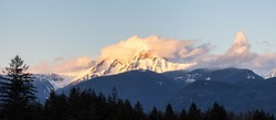 Panoramic View of Canadian Mountain Landscape covered in Clouds. Colorful Sunset Sky. Mt Garibaldi in Squamish, British Columbia, Canada. Nature Background Panorama