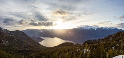 Panoramic View of Canadian Nature Mountain Landscape from Sea to Sky Gondola Summit Viewpoint. Colorful Sunny Spring Sunset. Taken near Squamish, North of Vancouver, BC, Canada.
