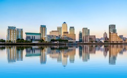 Panoramic view of Canary Wharf, financial hub in London at sunset
