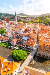 Panoramic view of Cesky Krumlov with St Vitus church in the middle of historical city centre. Cesky Krumlov, Southern Bohemia, Czech Republic.