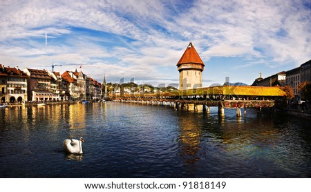 Panoramic view of Chapel Bridge, famous covered wooden bridge, and swan. Lucerne Switzerland.
