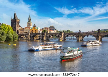 Panoramic view of Charles Bridge in Prague in a beautiful summer day, Czech Republic #533972647