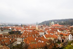 Panoramic view of city center with tiled red roofs, Prague, Czech Republic. Panoramic view of Old town of Prague with tiled roofs. Red roofs. Europe.