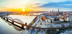 Panoramic view of city Riga,Latvia during late evening sunset. Old railway bridge in foreground.