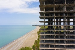 panoramic view of Coastline of the Black Sea coast near Kobuleti and abandoned sanatorium in Kobuleti, a high calving building on the first line.