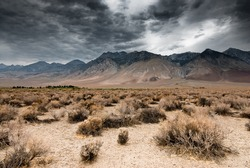 panoramic view of dark clouds in death valley national park, nevada, usa