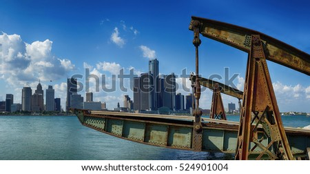 Panoramic view of Detroit city skyline taken at daylight from Windsor, Ontario during the summer