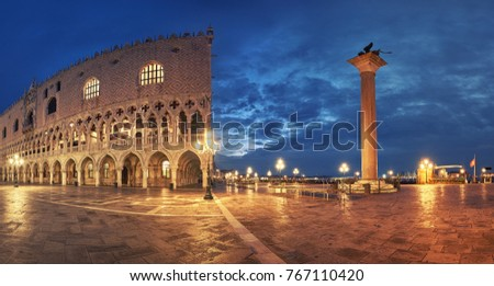 Panoramic view of Doge's Palace, or Doge Palace, and St. Marco's square a rainy night in Venice, Italy