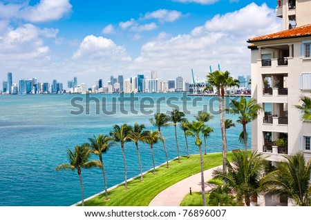 Panoramic view of Downtown Miami and Biscayne Bay with waterfront balconies.