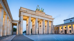 Panoramic view of famous Brandenburger Tor (Brandenburg Gate), one of the best-known landmarks and national symbols of Germany, in twilight during blue hour at dawn, Berlin, Germany