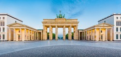 Panoramic view of famous Brandenburger Tor (Brandenburg Gate), one of the best-known landmarks and national symbols of Germany, in golden morning light at sunrise, Pariser Platz, Berlin, Germany