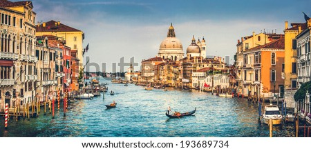 Panoramic view of famous Canal Grande and Basilica di Santa Maria della Salute at sunset in Venice Italy with retro vintage Instagram style filter effect