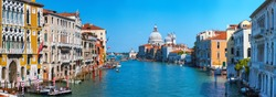 Panoramic view of famous Canal Grande and Basilica di Santa Maria della Salute in Venice, Italy.