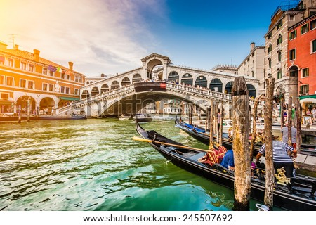 Panoramic view of famous Canal Grande from famous Rialto Bridge at sunset in Venice, Italy with retro vintage Instagram style filter effect #245507692