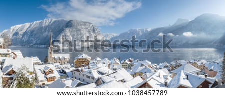 Panoramic view of famous Hallstatt lakeside town in the Austrian Alps on a beautiful cold sunny day with blue sky and clouds in winter, Salzkammergut, Upper Austria region, Austria Stock fotó ©