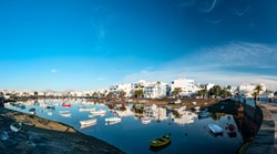 Panoramic view of  fisher boats at the laguna Charco de San Gines, city of Arrecife, Lanzarote, Canary Islands