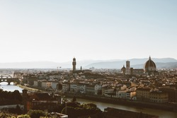 Panoramic view of Florence city with Cattedrale di Santa Maria del Fiore and Palazzo Vecchio from Piazzale Michelangelo (Michelangelo Square). Summer sunny day and dramatic blue sky