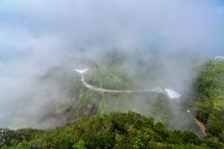 Panoramic view of fog,blue sky, sea, bridge and mountain seen from Langkawi Malaysia at Gunung Mat Cincang.This image may contain noise and blurry clouds due to long exposure