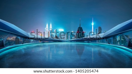 Panoramic view of futuristic geometric shapes design empty floor with Kuala Lumpur city skyline . Night scene .
