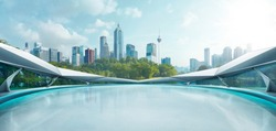 Panoramic view of futuristic geometric shapes design empty floor with morden city skyline . Morning scene .