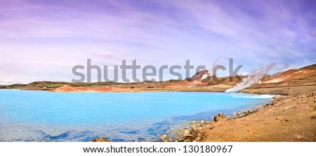 Panoramic view of geothermal landscape with beautiful azure blue crater lake, Myvatn area, north of Iceland