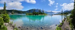 Panoramic view of glacial mountain Garibaldi lake with turquoise water on sunny summer day.islands with firs in the middle of the lake.  Garibaldi provincial park near Whistler, BC, Canada.