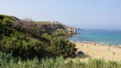 Panoramic view of Golden Bay (Ir-Ramla tal-Mixquqa) and Ghajn Tuffieha Tower on horizon. Mellieha. Malta.