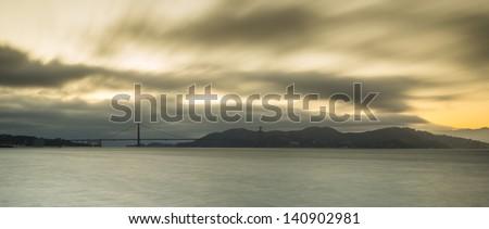 Panoramic view of Golden Gate Bridge in sunset