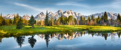 Panoramic view of Grand Teton range in Grand Teton National Park. Grand Teton National Park is in Wyoming, USA. Also, Grand Teton range is a range of mountains part of the US Rockies.