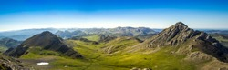panoramic view of green fields whit montains in north spain south europe asturias cordillera cantabrica