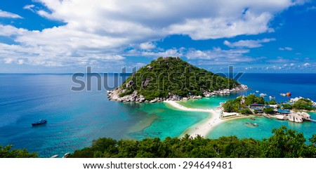 Panoramic view of green tropical island in Thailand against blue sky with clouds.  #294649481