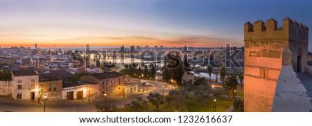 Panoramic view of Guadiana river from arabic citadel, Badajoz, Spain. Badajoz skyline at dusk