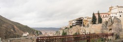 Panoramic view of Hanged Houses (Casas Colgadas) and San Pablo bridge in Cuenca, Spain.