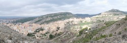 Panoramic view of Hanged Houses (Casas Colgadas) and San Pablo bridge in Cuenca (Spain) taking from a hill.