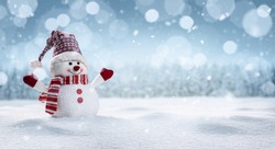 Panoramic view of happy snowman in winter scenery with copy space