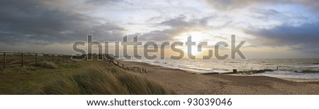 Panoramic view of Hengistbury Head from Southbourne at sunrise